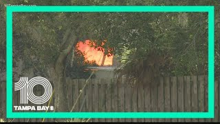 Deputies: Men had about 10,000 rounds of ammo,  chemical tanks in garage before explosion, fire