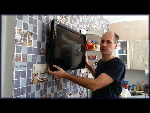 видео: Как закрепить жк или плазменный телевизор к стене через кронштейн