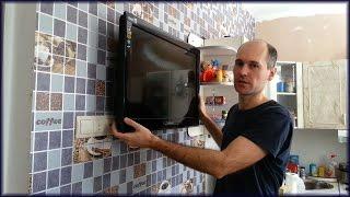 Как закрепить жк или плазменный телевизор к стене через кронштейн(В этом видео показано как закрепить телевизор ЖК (жидкокристаллический) или плазму к стене на кухне, для..., 2016-05-16T05:19:16.000Z)