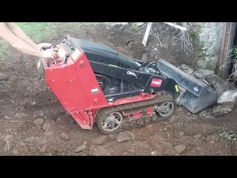 Toro Dingo/mini Push Skid Steer Digging In The Dirt