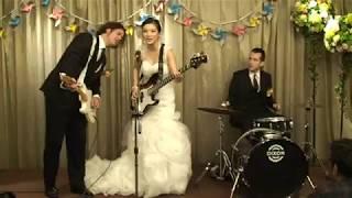Bride on bass, Groom on drums, Best man on Guitar