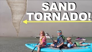 sand tornado blows kids out to sea