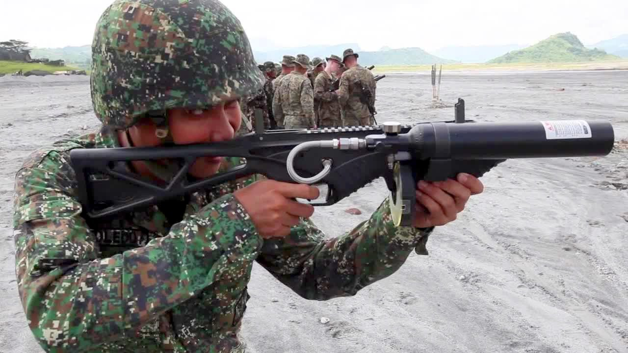 US, Philippine Marines Non-Lethal Weaponry: Taser, Riot Gun, Stingball  Grenades