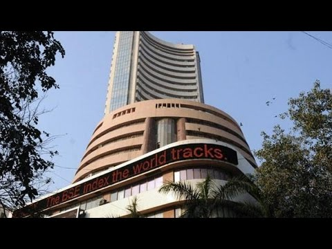 Sensex trading low,Rupee up 9 paise against dollar
