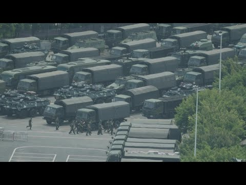 AFPTV EXCLUSIVE: Chinese Military Personnel Parade Near Hong Kong Border | AFP