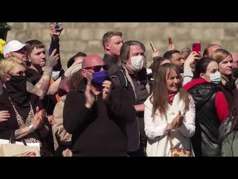 Semi-nude protester interjects during minute's silence at Windsor