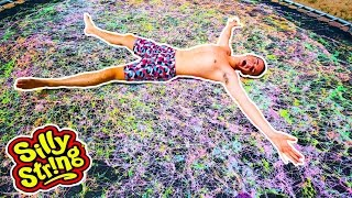 100+ CANS OF SILLY STRING VS TRAMPOLINE!