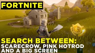 Search between a Scarecrow, Pink Hotrod and a Big Screen - Fortnite Challenge Guide