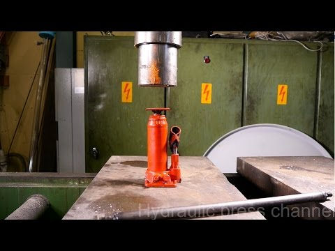 Crushing bottle jack and blast shield with hydraulic press