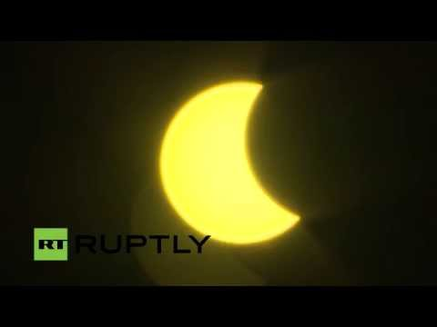LIVE: 'Supermoon' blocks out the sun above Moscow