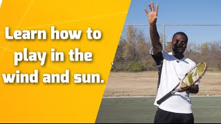 Tennis Lesson: Learn how to play in the wind and sun.