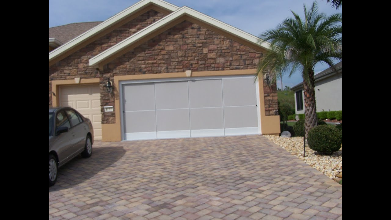 Retractable garage door - Garage Door Sliding Screens Roll Up Skeet R Beat R Retractable Screens Gainesville Youtube