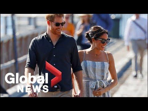 Meghan Markle cradles stomach as she rejoins Prince Harry on Fraser Island