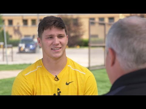 Wyoming Chronicle - UW Quarterback Josh Allen & Wyoming Associate Head Coach Brent Vigen