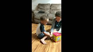 Kids play with Jack in the Box (Vintage Toy)