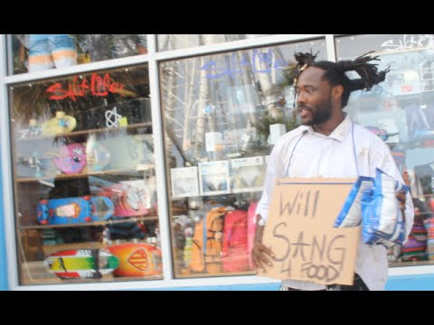 Homeless man sings John Legend's 'All Of Me'