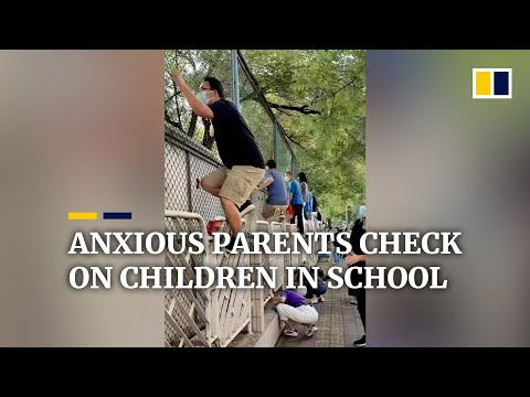 Anxious parents in China climb fence to check on children in school
