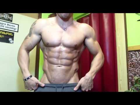 TEEN MUSCLE BOY FLEXING  HIS  SIX PACK ABS