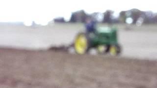 John deere 37 A plowing in road gear