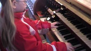 7 years old child plays a real church organ in Bavaria