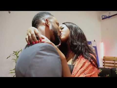 David Jones David (DJD) and Ini Dima Okojie kissing passionately.