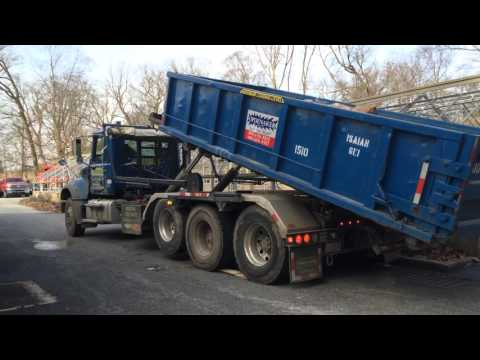 Roll off dumpster pickup