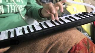 Diljaan  Roohdari  Playing Melodica