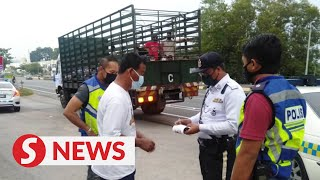Cops track down lorry packed with 48 Covid-19 positive workers in Kedah