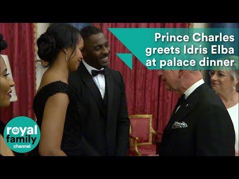 Prince Charles greets Idris Elba at palace dinner