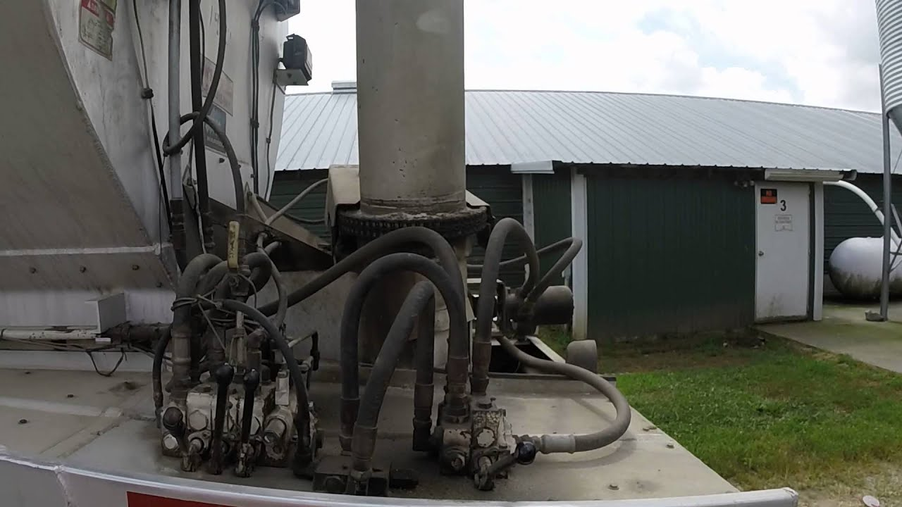 unloading feed at a farm