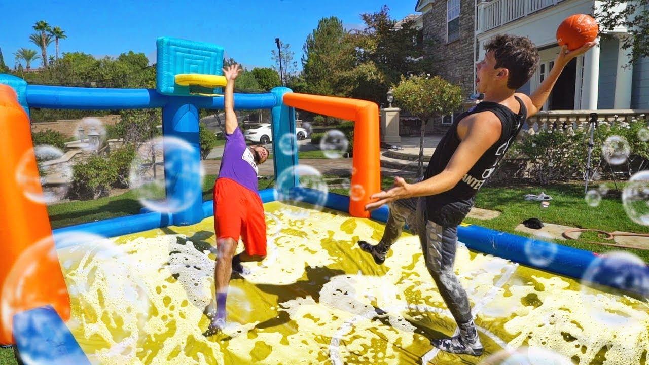 dangerous-slip-n-slide-inflatable-basketball-challenge
