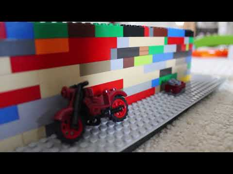 Showing LEGO House with miniature motorcycle, stove, dog house, etc.