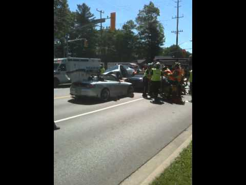 Car Drives on top of two sports cars - Crazy accident