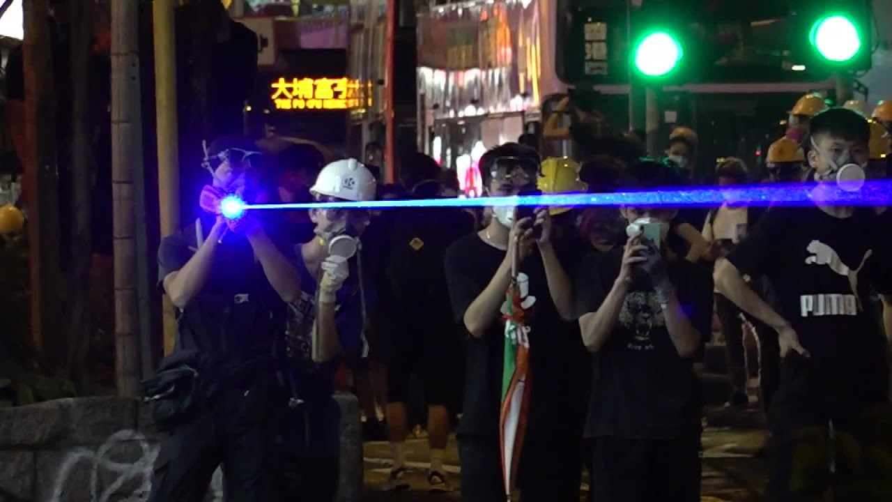 Protesters target laser beams at police officers in Hong Kong| How harmful are the laser beams?