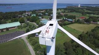 Drone Captures Man Sunbathing on Wind Turbine(A drone pilot in Rhode Island captured video of a man sunbathing on top of a 200 ft. tall wind turbine. The man pleasantly waves at the drone. Hi and welcome to ..., 2015-08-28T00:16:28.000Z)