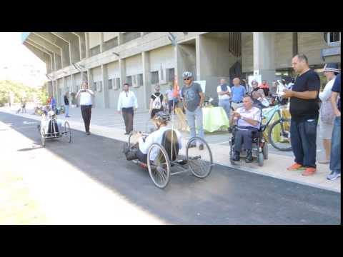 Tel Aviv mayor Ron Huldai and Tourism Minister Yariv Levin on hand cycles