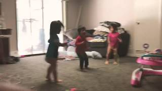 Silly toddlers pretending to jump rope!