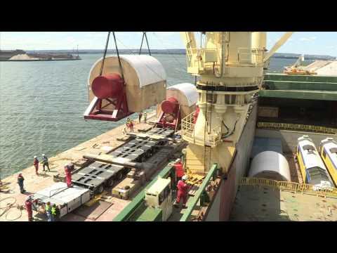 McKeil Marine Tug Barge Loading Cargo from Jumbo Ship