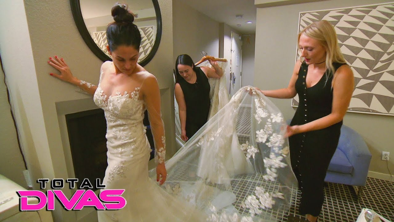 Nikki Bella tries on wedding dresses for the first time ...