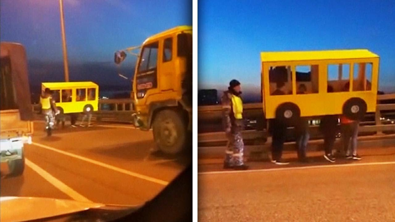 people-disguised-as-bus-try-to-cross-vehicles-only-bridge-on-foot