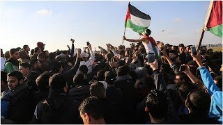 Palestinians rally to mark anniversary of .Great March of Return.., From YouTubeVideos