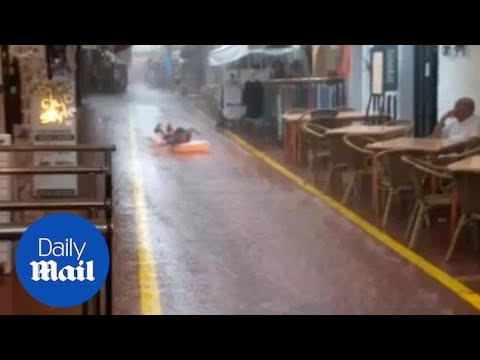 Brave Brit Slides Down Ibiza Street On Lilo During Rainstorm - Daily Mail