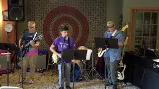 Ryan, Julian and Robert Performing Welcome To Paradise Main Street Music and Art Studio
