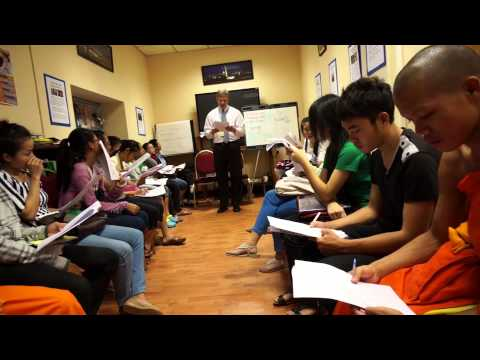 Deputy Chief of Mission Paul Mayer teaches English Language Students to Rap.