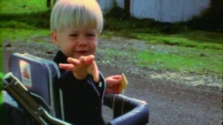 Baby Kurt Cobain kissing the camera and playing guitar - Montage of Heck clip