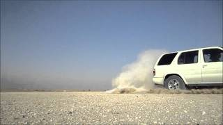 Nissan Pathfinder drifting in Dubai desert