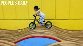 Look how this 2-year-old toddler starts her balance bike journey.