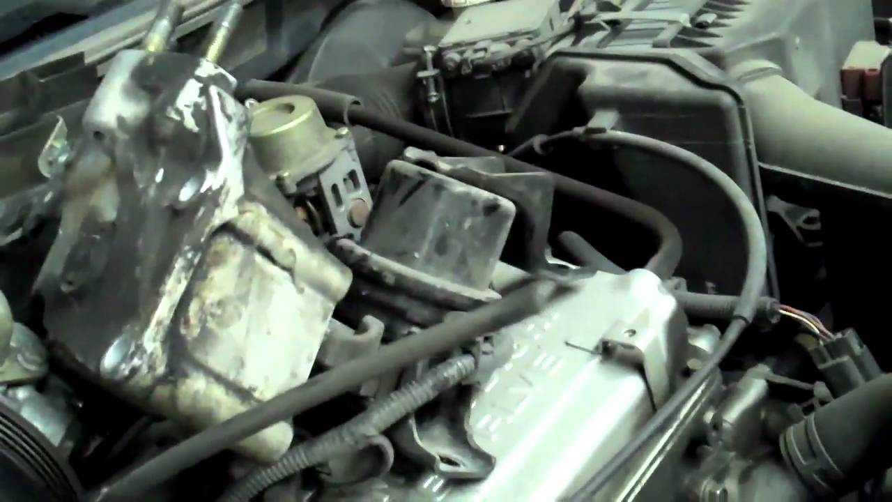 change the timing belt and water pump Mitsubishi Lancer - YouTube