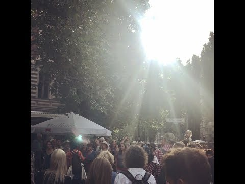 Angel flying as Choir sings in the Streets of Berlin