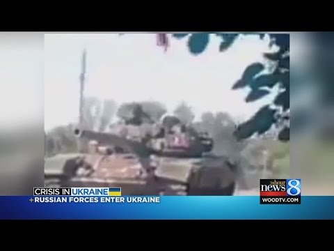 Russian columns enter Ukraine; leader urges calm
